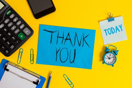 Writing note showing Thank You. Business concept for a polite expression used when acknowledging a gift or service Clipboard sheet calculator pencil clock smartphone color background