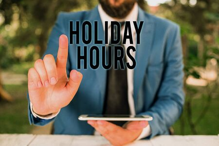 Word writing text Holiday Hours. Business photo showcasing employee receives twice their normal pay for all hours Businessman with pointing finger in front of him