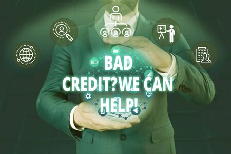 Writing note showing Bad Credit Question We Can Help. Business concept for offering help after going for loan then rejected Male human wear formal work suit presenting using smart device Stok Fotoğraf