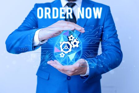 Handwriting text writing Order Now. Conceptual photo the activity of asking for goods or services from a company Man net gears bubble hands suit machinery stuff office technological device