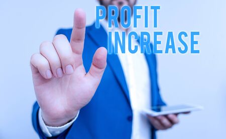 Conceptual hand writing showing Profit Increase. Concept meaning the growth in the amount of revenue gained from a business Businessman with pointing finger in front of him Stok Fotoğraf