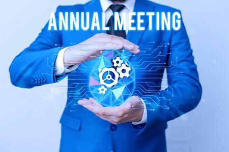 Handwriting text writing Annual Meeting. Conceptual photo yearly meeting of the general membership of an organization Man net gears bubble hands suit machinery stuff office technological device