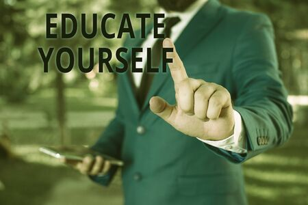 Word writing text Educate Yourself. Business photo showcasing prepare oneself or someone in a particular area or subject Businessman with pointing finger in front of him