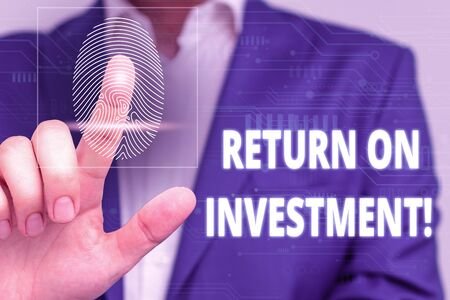 Conceptual hand writing showing Return On Investment. Concept meaning perforanalysisce measure used evaluate efficiency of investment Male wear formal work suit presenting presentation smart device