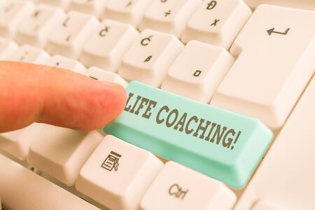 Conceptual hand writing showing Life Coaching. Concept meaning demonstrating employed to help showing attain their goals in career White pc keyboard with note paper above the white background