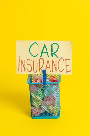 Handwriting text Car Insurance. Conceptual photo Accidents coverage Comprehensive Policy Motor Vehicle Guaranty Trash bin crumpled paper clothespin empty reminder office supplies yellow