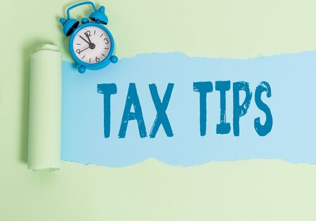 Handwriting text writing Tax Tips. Conceptual photo compulsory contribution to state revenue levied by government Imagens