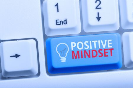 Writing note showing Positive Mindset. Business concept for mental attitude in wich you expect favorable results Keyboard with note paper on white background key copy space