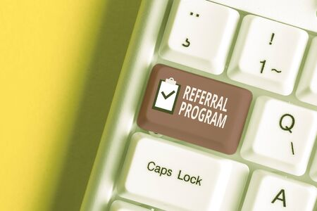 Handwriting text writing Referral Program. Conceptual photo employees are rewarded for introducing suitable recruits White pc keyboard with empty note paper above white background key copy space