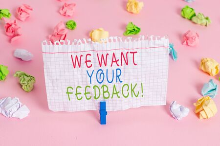 Conceptual hand writing showing We Want Your Feedback. Concept meaning criticism given someone say can be done for improvement Colored crumpled papers empty reminder pink floor clothespin