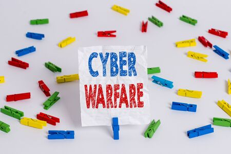 Text sign showing Cyber Warfare. Business photo showcasing Virtual War Hackers System Attacks Digital Thief Stalker Colored clothespin papers empty reminder white floor background office