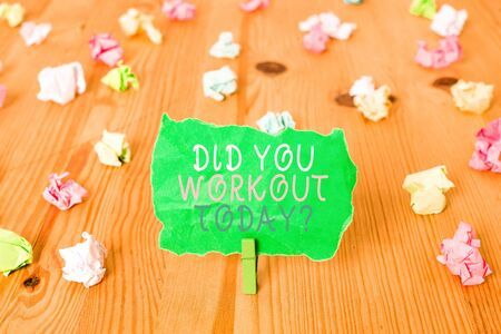 Word writing text Did You Workout Today. Business photo showcasing asking if made session physical exercise Colored crumpled papers empty reminder wooden floor background clothespin