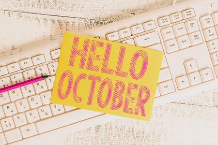 Text sign showing Hello October. Business photo showcasing Last Quarter Tenth Month 30days Season Greeting White keyboard office supplies empty rectangle shaped paper reminder wood