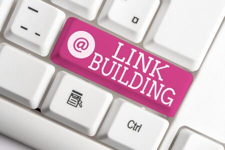 Writing note showing Link Building. Business concept for SEO Term Exchange Links Acquire Hyperlinks Indexed White pc keyboard with note paper above the white background