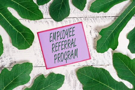 Writing note showing Employee Referral Program. Business concept for employees are rewarded for introducing recruits