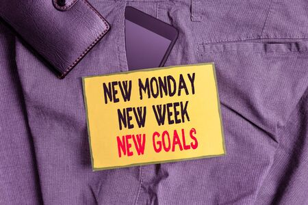Conceptual hand writing showing New Monday New Week New Goals. Concept meaning showcasing next week resolutions To do list Smartphone device inside trousers front pocket with wallet