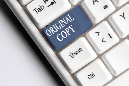 Text sign showing Original Copy. Business photo text Main Script Unprinted Branded Patented Master List White pc keyboard with empty note paper above white background key copy space