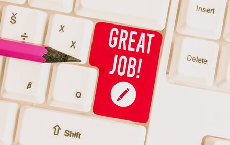 Writing note showing Great Job. Business concept for sed for telling someone that they have done something well White pc keyboard with note paper above the white background