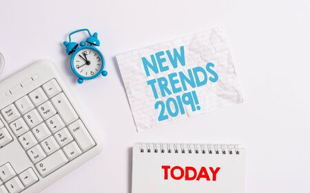 Text sign showing New Trends 2019. Business photo showcasing general direction in which something is developing Blank paper with copy space on the table with clock and pc keyboard 版權商用圖片