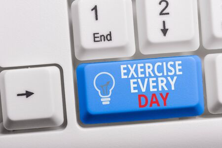 Writing note showing Exercise Every Day. Business concept for move body energetically in order to get fit and healthy Keyboard with note paper on white background key copy space