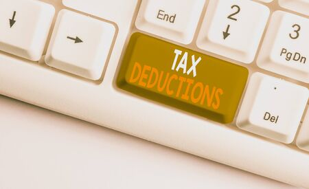 Text sign showing Tax Deductions. Business photo showcasing an amount or cost that subtracted from someone s is income White pc keyboard with empty note paper above white background key copy space Stock fotó
