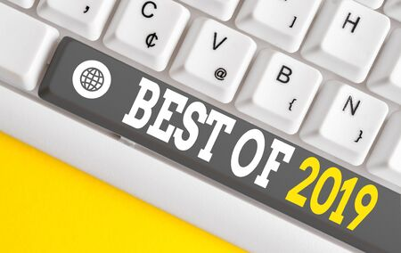 Writing note showing Best Of 2019. Business concept for great and marvelous things and events happened on 2019 White pc keyboard with note paper above the white background Stock Photo