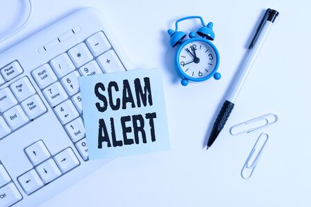 Conceptual hand writing showing Scam Alert. Concept meaning unsolicited email that claims the prospect of a bargain White pc keyboard with empty note paper above white background Stockfoto