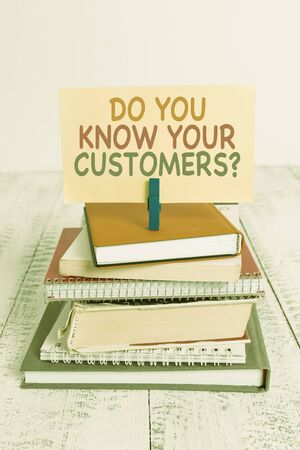 Conceptual hand writing showing Do You Know Your Customers question. Concept meaning asking to identify a customer s is nature pile stacked books notebook pin color reminder white wooden Foto de archivo - 130020942