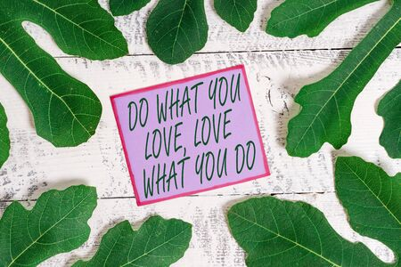 Writing note showing Do What You Love Love What You Do. Business concept for Pursue your dreams or passions in life Stock fotó