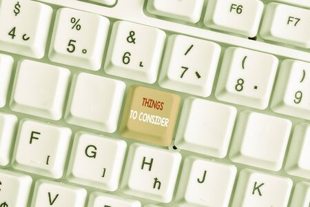 Writing note showing Things To Consider. Business concept for think about carefully especially in making decisions White pc keyboard with note paper above the white background Stok Fotoğraf - 130021115