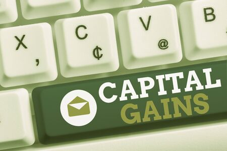 Word writing text Capital Gains. Business photo showcasing Bonds Shares Stocks Profit Income Tax Investment Funds White pc keyboard with empty note paper above white background key copy space