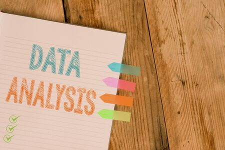Handwriting text writing Data Analysis. Conceptual photo Translate numbers to Analytical Conclusion Forecasting Striped note book four colored arrow banners reminder wooden background