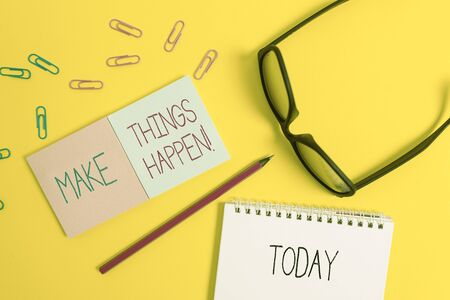 Text sign showing Make Things Happen. Business photo showcasing you will have to make hard efforts in order to achieve it Square blank sticky notepads pencil clips eyeglasses yolk color background