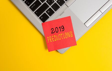 Writing note showing 2019 Predictions. Business concept for statement about what you think will happen in 2019 Metallic trendy laptop blank sticky note empty text colored background