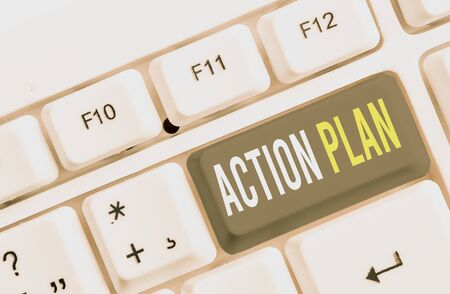 Writing note showing Action Plan. Business concept for detailed plan outlining actions needed to reach goals or vision White pc keyboard with note paper above the white background