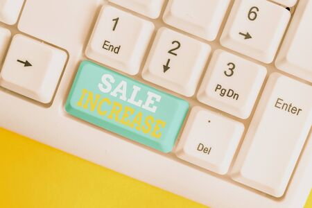 Writing note showing Sale Increase. Business concept for Average Sales Volume has Grown Boost Income from Leads White pc keyboard with note paper above the white background Stock Photo