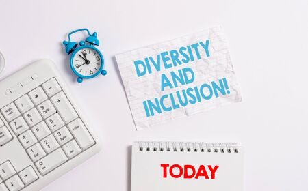 Text sign showing Diversity And Inclusion. Business photo showcasing range huanalysis difference includes race ethnicity gender Blank paper with copy space on the table with clock and pc keyboard