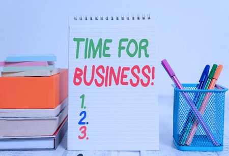 Text sign showing Time For Business. Business photo text fulfil transactions within period promised to client Pens metal holder stacked note pads books square box spiral wooden table 스톡 콘텐츠