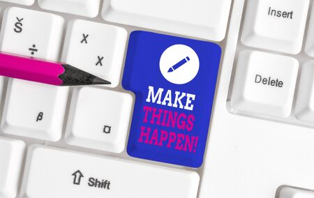 Writing note showing Make Things Happen. Business concept for you will have to make hard efforts in order to achieve it White pc keyboard with note paper above the white background
