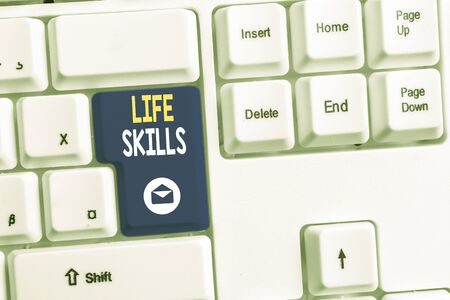 Word writing text Life Skills. Business photo showcasing skill that is necessary for full participation in everyday life White pc keyboard with empty note paper above white background key copy space