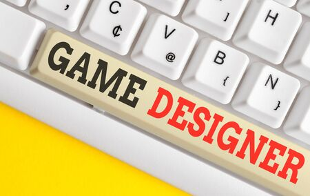 Text sign showing Game Designer. Business photo text Campaigner Pixel Scripting Programmers Consoles 3D Graphics White pc keyboard with empty note paper above white background key copy space 스톡 콘텐츠