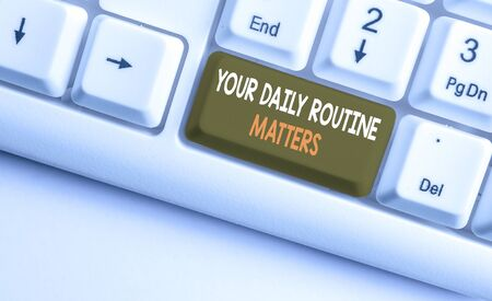 Text sign showing Your Daily Routine Matters. Business photo showcasing practice of regularly doing things in fixed order White pc keyboard with empty note paper above white background key copy space
