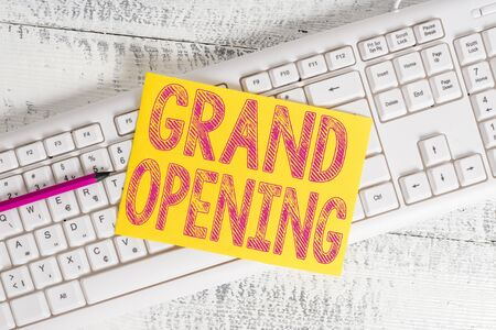 Text sign showing Grand Opening. Business photo showcasing Ribbon Cutting New Business First Official Day Launching White keyboard office supplies empty rectangle shaped paper reminder wood 스톡 콘텐츠