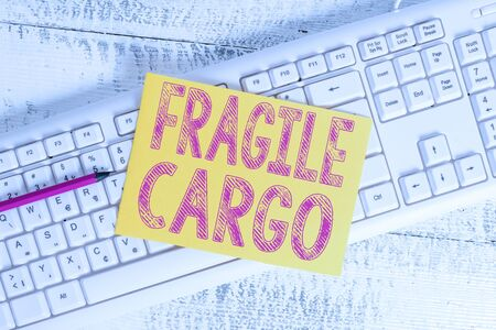 Text sign showing Fragile Cargo. Business photo showcasing Breakable Handle with Care  Glass Hazardous Goods White keyboard office supplies empty rectangle shaped paper reminder wood