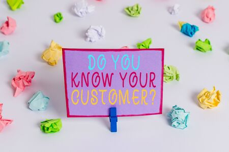 Writing note showing Do You Know Your Customer Question. Business concept for service identify clients with relevant information Colored crumpled paper empty reminder white floor clothespin