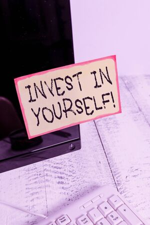 Word writing text Invest In Yourself. Business photo showcasing nvesting in a coach or a training to learn new things Notation paper taped to black computer monitor screen near white keyboard