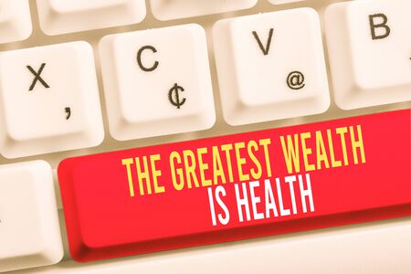 Word writing text The Greatest Wealth Is Health. Business photo showcasing Many sacrifice their money just to be healthy White pc keyboard with empty note paper above white background key copy space 스톡 콘텐츠