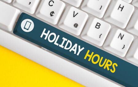 Word writing text Holiday Hours. Business photo showcasing employee receives twice their normal pay for all hours White pc keyboard with empty note paper above white background key copy space Reklamní fotografie