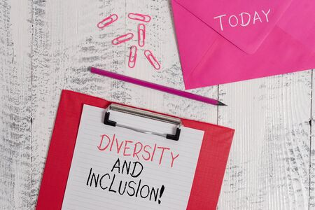 Conceptual hand writing showing Diversity And Inclusion. Concept meaning range huanalysis difference includes race ethnicity gender Colored clipboard paper sheet pencil clips wooden background