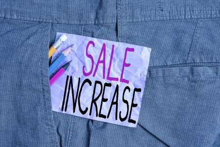 Conceptual hand writing showing Sale Increase. Concept meaning Average Sales Volume has Grown Boost Income from Leads Writing equipment and purple note paper inside pocket of trousers